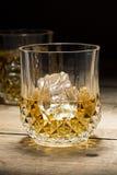 半满白兰地酒的玻璃 免版税库存图片