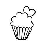 华伦泰与一心脏的杯形蛋糕剪影 库存照片