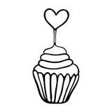 华伦泰与心脏轻便短大衣的杯形蛋糕剪影 免版税库存图片