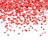 华伦泰瓣心脏五彩纸屑落在白色背景的 免版税图库摄影