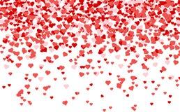 华伦泰瓣心脏五彩纸屑落在白色背景的 免版税库存照片