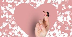 华伦泰的手指爱夫妇和心脏 库存照片