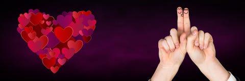 华伦泰的手指爱夫妇和心脏 图库摄影