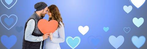 华伦泰结合拿着心脏有爱心脏背景 库存照片