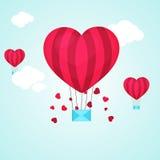 华伦泰` s天庆祝的热空气气球 免版税库存图片