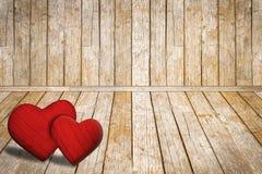 华伦泰` s天背景,在老木地板上的红色心脏 免版税库存图片