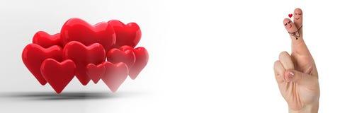 华伦泰` s手指爱夫妇和小组心脏 库存图片