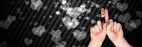 华伦泰` s手指爱夫妇和灰色心脏 库存图片