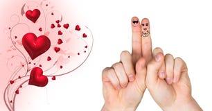 华伦泰` s手指爱夫妇,并且打旋的心脏设计 免版税库存照片