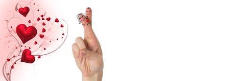 华伦泰` s手指爱夫妇,并且打旋的心脏设计 免版税图库摄影