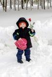 华伦泰` s有玫瑰色和糖果的天孩子 图库摄影