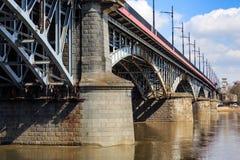 在维斯瓦河,华沙的Poniatowski桥梁 库存照片