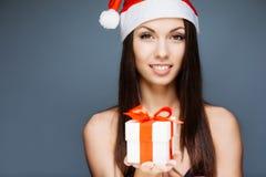 华美的圣诞老人女孩 库存图片