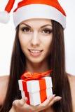 华美的圣诞老人女孩 图库摄影