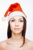 华美的圣诞老人女孩 库存照片