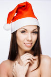 华美的圣诞老人女孩 免版税库存照片