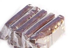 单个被包裹的果仁巧克力 免版税库存照片