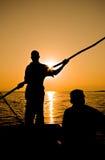 单桅三角帆船划船者 库存图片
