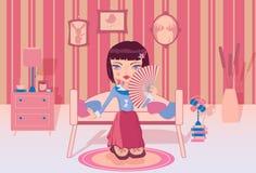 单独坐在她的屋子里的逗人喜爱的女孩 库存图片