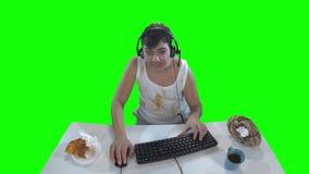 单薄的游戏玩家人 绿色屏幕 股票录像