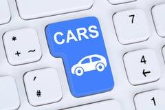 卖或买汽车在计算机上的网上按钮 免版税库存图片