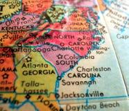 南卡罗来纳美国状态集中宏观射击于旅行博克、社会媒介、网横幅和背景的地球地图 免版税库存照片