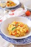南瓜意大利煨饭和杯白葡萄酒 库存照片