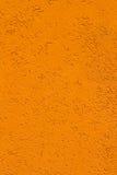 南瓜橙色灰泥墙壁纹理背景 免版税库存照片