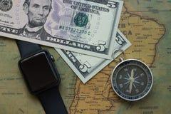 南美葡萄酒地图有五张忧伤票据、手表和指南针的,特写镜头 库存照片