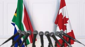 南非和加拿大的旗子在国际会议或交涉新闻招待会 影视素材