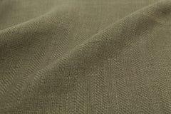 卡其色的背景豪华布料或难看的东西丝绸textu波浪折叠  库存图片