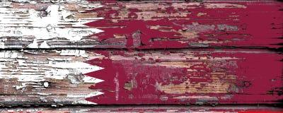卡塔尔的国旗木背景的 库存照片