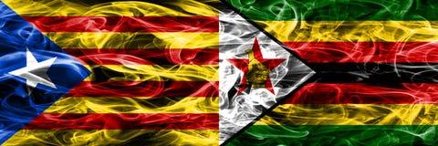 卡塔龙尼亚对津巴布韦拷贝肩并肩被安置的烟旗子 加泰罗尼亚语和津巴布韦的浓厚色的柔滑的烟旗子复制 免版税库存照片
