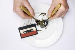 卡式磁带吃 免版税库存图片