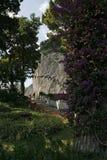 卡普里岛海岛,在山的著名路与花 免版税库存照片