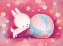 卡片用使用与球的小的野兔 库存图片