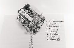 卡车引擎坐开放笔记本 免版税图库摄影