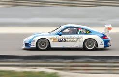 卡里姆Al赛跑在保时捷GT3杯期间的Al Nabooda Azhari 2013年 免版税图库摄影