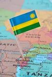 卢旺达在地图的旗子别针 库存照片