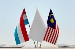 卢森堡和马来西亚的旗子 库存图片