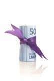 卢比-与紫色磁带的印度尼西亚金钱 免版税图库摄影
