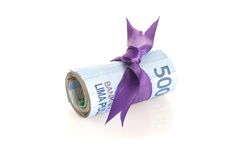 卢比-与紫色磁带的印度尼西亚金钱 图库摄影