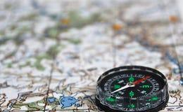 卫星冒险-地图和指南针 图库摄影