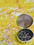 卫星冒险-地图和指南针 免版税库存照片