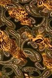 印刷品织品纹理镶边了豹子和花backgroun的 库存照片