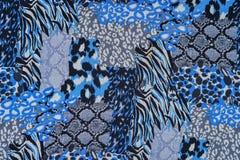 印刷品织品纹理镶边了豹子和蛇皮革 免版税库存照片