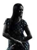 印地安妇女剪影 库存图片