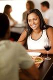 年轻印地安妇女在餐馆 免版税图库摄影