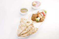 印地安盘Kathi Kebab或混合大豆, Chees Masla盘  免版税库存图片