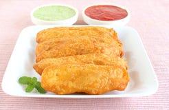 印地安食物未加工的香蕉油炸馅饼 库存图片